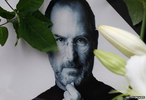Picture of Steve Jobs, with flowers