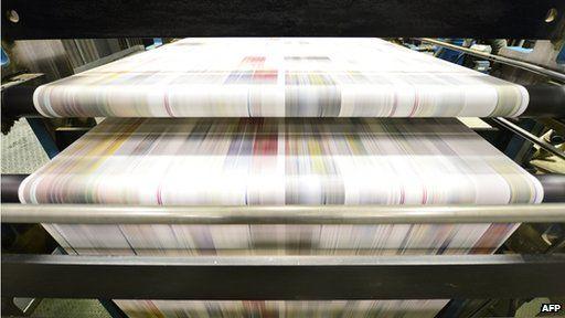 Newspapers on printing press