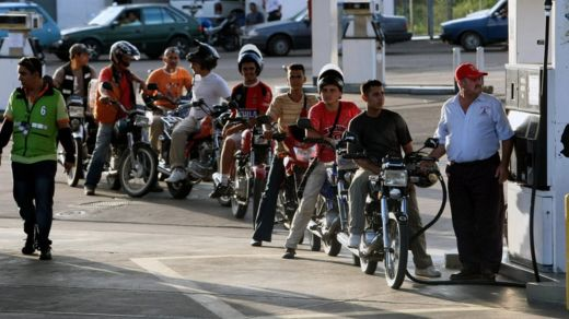 Motorbikes cueing at a petrol station in Venezuela