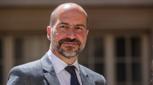 Dara Khosrowshahi arrives at a tech summit in Paris