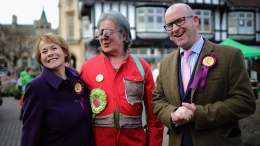 UKIP's Victoria Ayling and UKIP party leader Paul Nuttall are serenaded by David Bishop (C) the candidate for the Bus-Pass Elvis Party on December 3, 2016 in Sleaford, England.