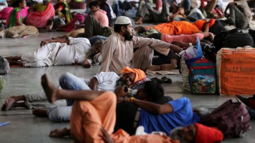 Stranded passengers wait for train services to resume at a railway station after their trains were cancelled following Cyclone Fani, in Ahmedabad, India May 3, 2019