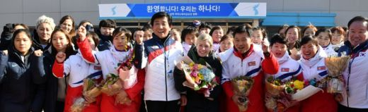 Sarah Murray, head coach of the combined women's ice hockey team, is seen as the North Korean women's ice hockey players arrive at South Korea's national training centre in Jinchoen on 25 January 2018