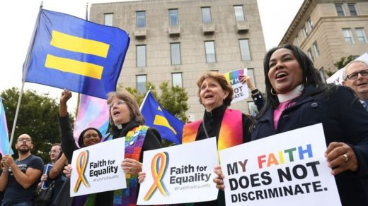 Demonstrators in favor of LGBT rights rally outside the US Supreme Court in Washington, DC, 8 October, 2019