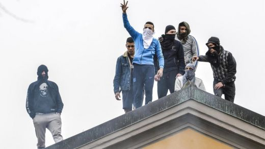 Detainees protest on the roof of the San Vittore prison in Milan, northern Italy, 9 March 2020