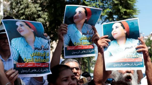 Moroccan activists hold posters of Hajar Raissouni at a protest outside the Rabat tribunal. File photo