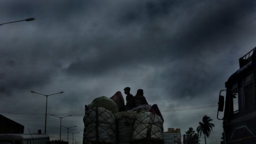 Vegetable vendors travel on a truck with dense clouds are overhead as Cyclone Fani made landfall at neighbouring West Midnapore of West Bengal some 200km west of Kolkata, Eastern India, 03 May 2019