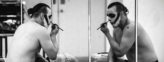 Wrestler applying makeup