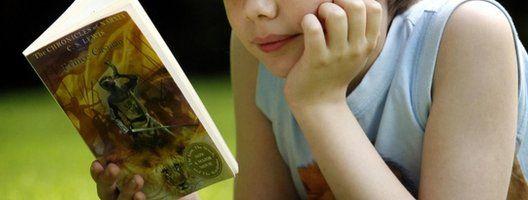 Boy reading novel