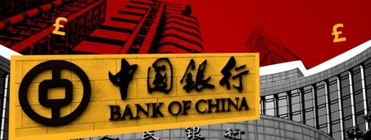 Bank of China sign against backdrop of currency signs and buildings.