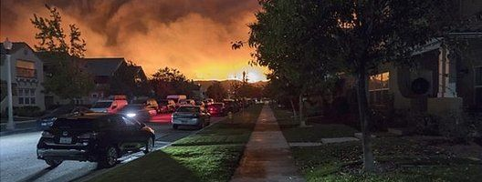Image depicting an explosion on the horizon of a suburban landscape