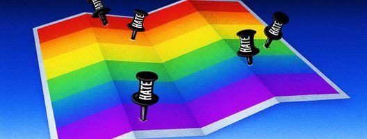 A LGBT flag folded like a map with pins saying 'Hate'