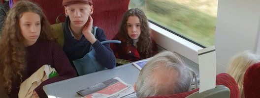Amanda Mancino-Williams's children stare at a couple who refused to leave their reserved seats