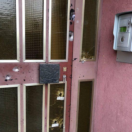 Bullet holes could be seen in the door where Chekatt had been hiding before he died
