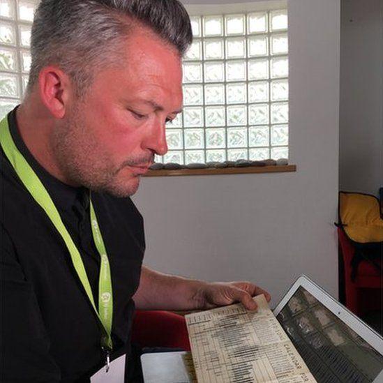 Justin looking at birdsong calendar