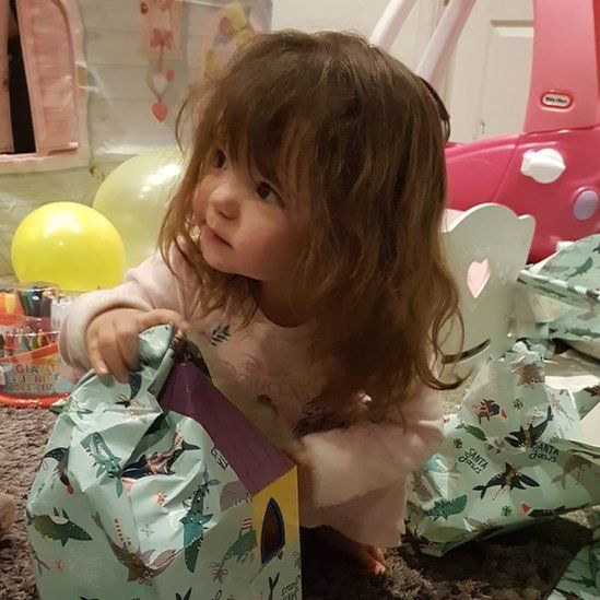 Abigail opening her presents