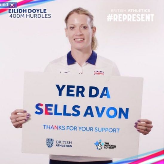 Eilidh Doyle holds a sign superimposed with the slogan: Yer Da sells Avon