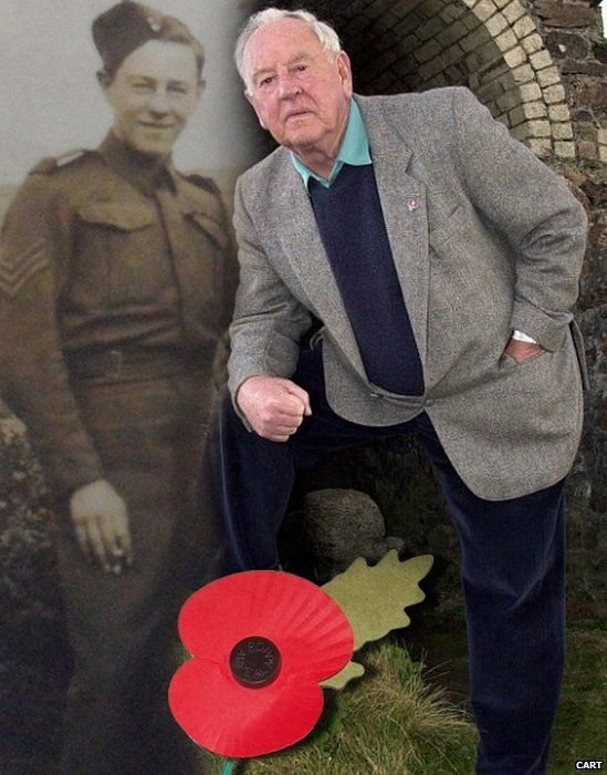 Trevor Miners with a photo of himself taken in the 1940s