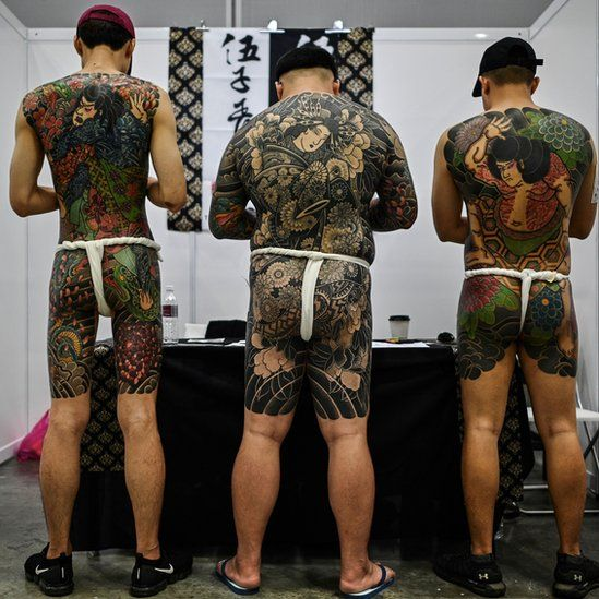 The half-naked men with tattoos