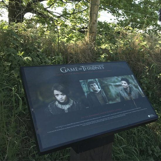 A sign at the Dark Hedges marks the site's contribution to the TV show