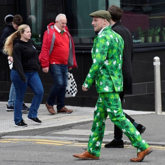 Man in green suit covered in shamrocks