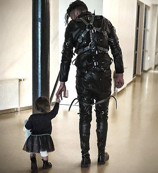 A band member walks with a child after their winning performance in Iceland
