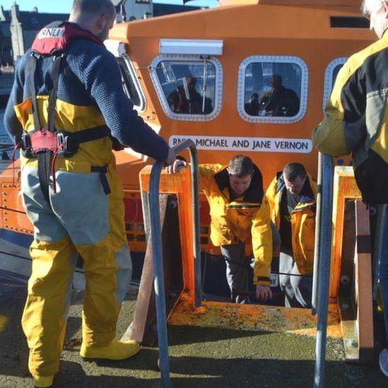 Crew back via lifeboat