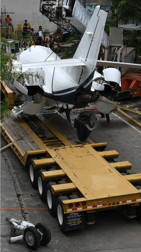 The aircraft went off the runway and collapsed over a busy boulevard while landing at Toncontin International airport in Tegucigalpa