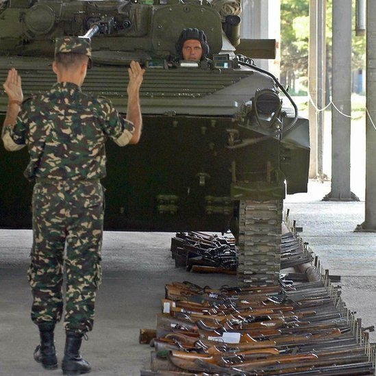 Macedonian army tank rolls over guns gathered during a voluntary disarmament drive in the volatile Balkans country (9 July 2004)
