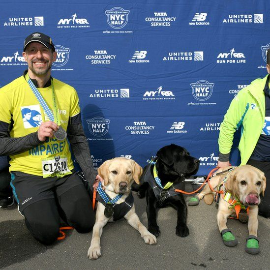 Thomas Panek after running the New York City Half Marathon with his guide dogs