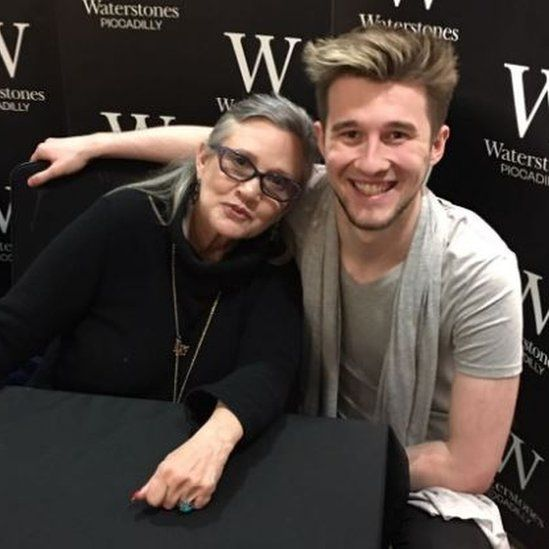 Photo of John Moore at a book signing with Carrie Fisher