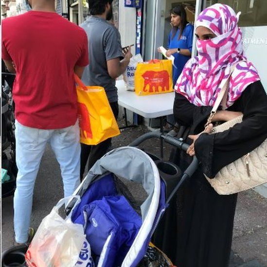 Rahemunissa Shaik with groceries
