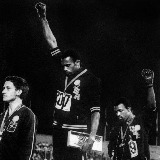 Black American athletes Tommie Smith (centre) and John Carlos
