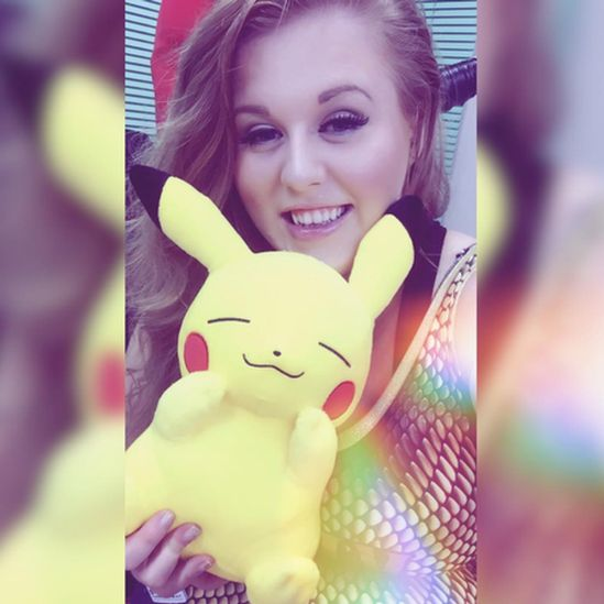 woman with pikachu toy