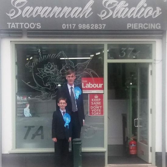 A picture of the MP and his young son standing outside a tattoo parlour which has a Labour sign in the window. Rees-Mogg shared this image of him campaigning with his young son with the caption 'We shall have to take our business elsewhere'. It was liked thousands of times.