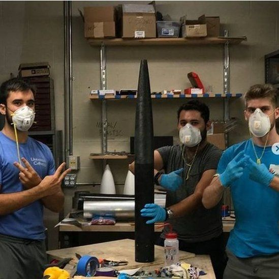 Students working on building the rocket