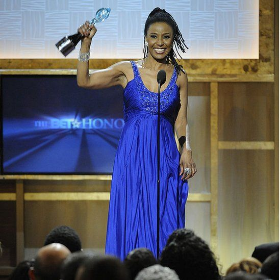 Smith accepts an award from Black Entertainment Television (BET) in 2009