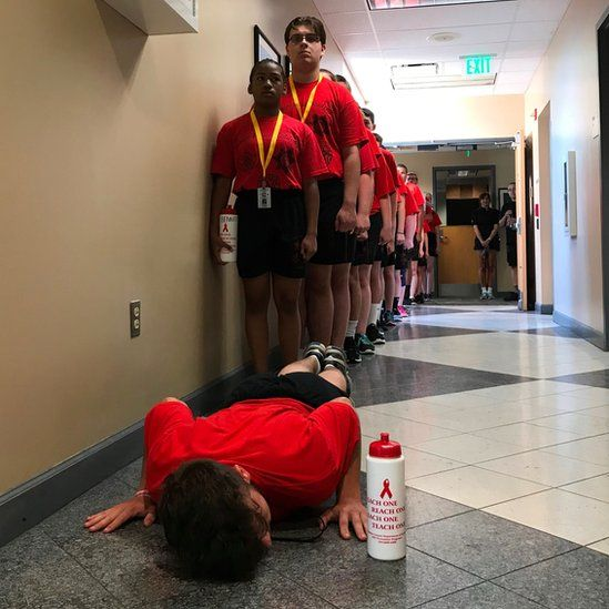 Junior cadet is made to do push-ups after a room inspection