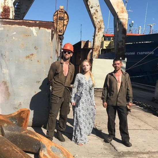 Liza at the shipyard with workers