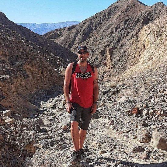 Jason Heser hiking in Death Valley National Park