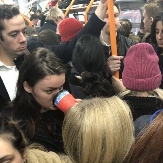 Passengers in Guildford - Waterloo train