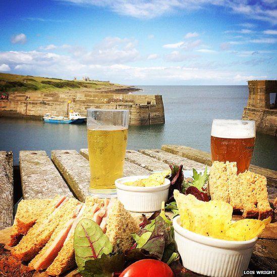 Food on a table overlooking coast