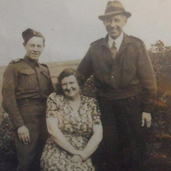 Trevor Miners with his parents