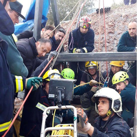 A handout photo made available by the Andalusian Government shows rescue teams working at the borehole where two-year-old boy Julen fell into back on 13 January