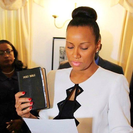 Anya Williams holds up a Bible as she is sworn in
