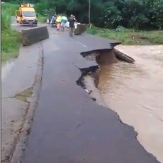 People look at a road damaged due to Dorian in Riviere-Pilote, Martinique