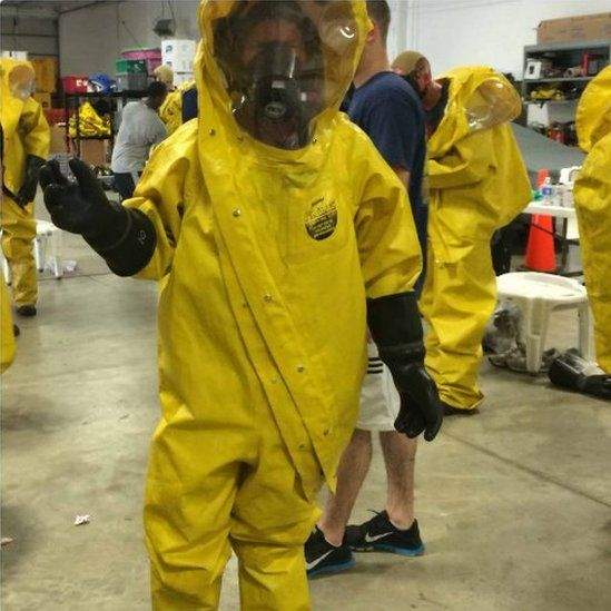 Picture of a woman wearing a Biohazard suit