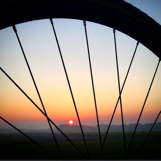 Sunrise through a wheel