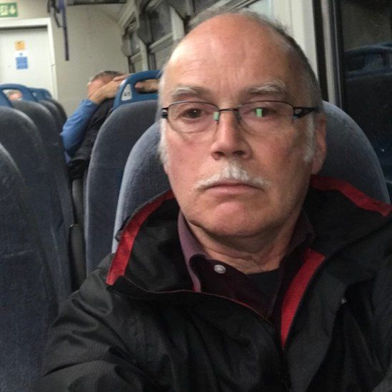 Phil Owen on a train