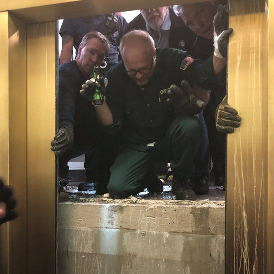 Rescuers open the lift door to reach those trapped, on 16 November 2018